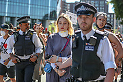A person is arrested by police officers during a protest against the death in Minneapolis police custody of African-American man George Floyd in front of the U.S. Embassy, London, Britain, May 31, 2020