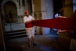 June 18, 2017 - Barcelona, Catalonia, Spain - A man gets ready inside Barcelona's City Hall, Spain,  moments before taking part at the folkloric  procession of Corpus Christi on 18 June, 2017. (Credit Image: © Jordi Boixareu/NurPhoto via ZUMA Press)