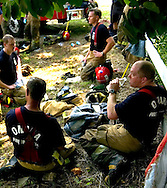 Omaha, Neb 5/27/06 Firefighters cool off after fighting a blaze at a house fire in north central Omaha, two blocks north east of 45th and Newport Ave Saturday afternoon..(Chris Machian/Prairie Pixel Group)