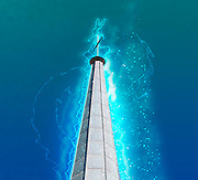 Digitally manipulated glowing image of a spire of church with a crucifix