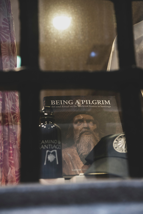 """A shop window displays items for sale, including the book """"Being a Pilgrim: Art and Ritual on the Medieval Routes to Santiago"""", in Santiago de Compostela, Spain. (July 15, 2018)<br /> <br /> DAY 49: STAYED IN SANTIAGO DE COMPOSTELA"""