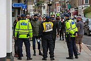 Police officers patrol the streets of Dover to keep apart members of Kent Anti Racism Network and far right facist groups who were also gathering to blockade the port of Dover on the 5th September 2020, Dover, Kent.  Members of Kent Anti Racism Network gathered today in Dover, Kent to stand in solidarity with those fleeing war, poverty and persecution making the extremely dangerous crossing to seek sanctuary in the UK.  (photo by Andrew Aitchison / In Pictures via Getty Images)