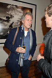 Musician JOHN ILLSLEY at a private view of photographs by renowned wildlife photographer David Yarrow in aid of TUSK entitled 'Wild Encounters' held at Somerset House on 19th September 2016.