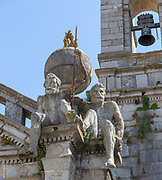 Church of Igreja de Nossa Senhora de Graca, Evora, Alto Alentejo, Portugal, southern Europe two stone Atlas-like figures sit on each corner nicknamed by locals the 'children of Grace'