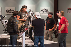 Custom builder Brad Gregory on his deraked Harley-Davidson Evo chopper while talking with Ray Drea, Paul Martin and other members of the Harley-Davidson design team in the Old Iron - Young Blood exhibiition during the annual Sturgis Black Hills Motorcycle Rally. SD, USA. Tuesday August 8, 2017.  Photography ©2017 Michael Lichter.