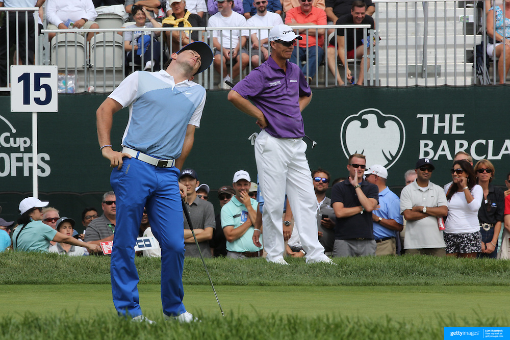 Rory McIlroy after missing a putt on the 15th hole during the third round of theThe Barclays Golf Tournament at The Ridgewood Country Club, Paramus, New Jersey, USA. 23rd August 2014. Photo Tim Clayton