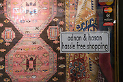 Turkey, Istanbul, Interior of the Grand Bazaar No Hassle Shopping sign on a Carpet shop window