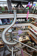 SHANGHAI, CHINA - APRIL 19: (CHINA OUT) <br /> <br /> A giant slide is seen inside a shopping mall on April 19, 2016 in Shanghai, China. The 18.9-meter-tall, 54-meter-long slide at a shopping mall trail opened to VIP customers nowadays. It would take about 16 second to slide down from the top on the fifth floor.<br /> ©Exclusivepix Media