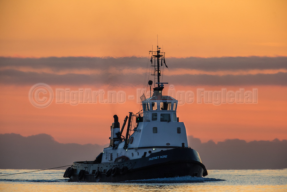 """""""Fastnet Nore"""" in sunset at Herøyfjord. Tug boat owned by Stadt Sjøtransport AS   """"Fastnet Nore"""" i solnedgang. Slepebåt eid av Stadt Sjøtransport AS."""