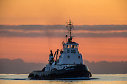 """""""Fastnet Nore"""" in sunset at Herøyfjord. Tug boat owned by Stadt Sjøtransport AS 