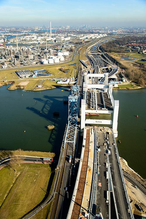 Nederland, Zuid-Holland, Rotterdam, 18-02-2015; bouw van de nieuwe Botlekbrug.<br /> De brug over de Oude Maas is een hefbrug, een van de twee brugdelen in geheven toestand. Links de oude brug, raffianderij van Shell Pernis in de achtergrond.<br /> Construction of the new Botlek bridge.<br /> The bridge over the Oude Maas is a vertical-lift bridge or lift bridge, one of the two bridge sections raised. <br /> luchtfoto (toeslag op standard tarieven);<br /> aerial photo (additional fee required);<br /> copyright foto/photo Siebe Swart