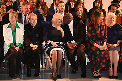 The Duchess of Cornwall (centre) chats with British Vogue Editor Edward Enninful (centre right) on the front row during a visit to London Fashion Week at the BFC Show Space, London.