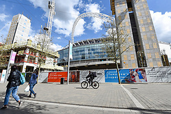 © Licensed to London News Pictures. 26/04/2018. LONDON, UK.  Ongoing construction continues around Wembley Stadium and its world famous arch.  It is reported that the Football Association (FA) has received a bid of GBP800m from Shahid Khan, owner of Fulham FC and the Jacksonville Jaguars NFL franchise, to purchase the stadium.  If the bid is successful, the FA will retain its organisational base at the stadium, but will open the way for the creation of the first NFL franchise located out of the United States.  Photo credit: Stephen Chung/LNP
