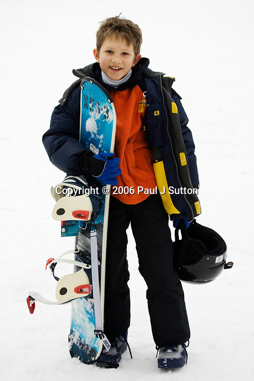 Portrait of young boy snowboarder