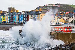 ©Licenced to London News Pictures - Aberystwyth, UK. 30/09/2018. Blustery cold winds at high tide bring big waves crashing against the harbour wall in Aberystwyth on the Cardigan Bay coast, west Wales on the last day of September 2018<br /> Photo cerdit: Keith Morris / LNP