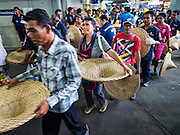 30 AUGUST 2016 - BANGKOK, THAILAND: People in line for a food and clothing distribution at the Poh Teck Tung shrine on the last day of Hungry Ghost Month in Bangkok. Chinese temples and shrines in the Thai capital host food distribution events during Hungry Ghost Month, during the 7th lunar month, which is usually August in the Gregorian calendar.         PHOTO BY JACK KURTZ