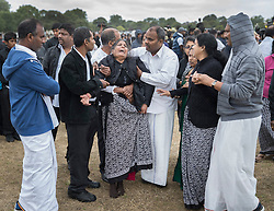 © Licensed to London News Pictures. 04/09/2016. London, UK. Friends and relatives mourn at a joint funeral held at Winn's Common Park for five men who drowned at Camber Sands last month.  The five men: Kurushanth Srithavarajah, brothers  Kenigan and Kobi Nathan, Inthushan Sri and Nitharsan Ravi were all friends from London.  They got into difficulty in the sea of Camber Sands on August 24. Photo credit: Peter Macdiarmid/LNP