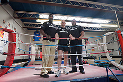 © Licensed to London News Pictures.10/04/2012. London, UK.  The Liberal Democrat mayoral candidate Brian Paddick (centre) poses with former Commonwealth and European heavyweight champion Derek Williams (left) and twice heavyweight world boxing champion Tim Witherspoon (right) after he  launched his manifesto at the Pedro Youth Club in Homerton today .Photo credit : James Gourley/LNP