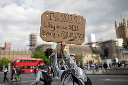 © Licensed to London News Pictures. 09/06/2020. London, UK. A protester walks across Parliament Square shortly after marking the funeral of George Floyd with a minute's silence. Protests have taken place across the United States and in cities around the world in response to the killing of George Floyd by police officers in Minneapolis on 25 May. Photo credit: Rob Pinney/LNP