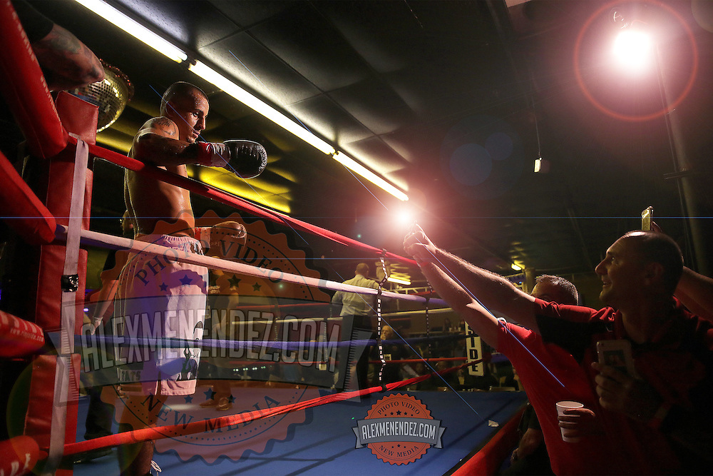 "Radivoje ""Hot Rod"" Kalajjdic knocks out Gilberto Domingos during the Mad Integrity Fight sports boxing match at the Florida Orange Event Center in Lakeland, Florida on Saturday October 10, 2015. Photo: Alex Menendez"