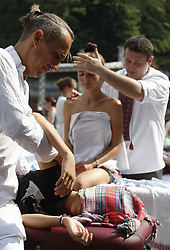 August 27, 2017 - Kiev, Ukraine - 300 Ukrainian masseurs and masseuses perform simultaneous massage in an attempt to break the Guinness World Record for massage, near Friendship of Nations Arch in Kiev, Ukraine, 27 August, 2017. The National Register of Records registered the record of Ukraine as ''The largest number of masseurs, which performing simultaneous massage' (Credit Image: © Str/NurPhoto via ZUMA Press)