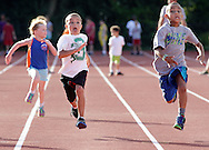 Alex Price and  Elijah Beamon, right, race to the finish line on the Middletown High School track during the Twilight Track and Field Series on Tuesday, July 30, 2013.