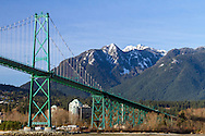 The iconic Lions Gate Bridge and Crown Mountain in West Vancouver.  Photographed from the Stanley Park seawall in Vancouver, British Columbia, Canada