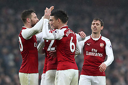 Arsenal's Shkodran Mustafi (left) and Laurent Koscielny celebrates victory with team-mates at full time of the Premier League match at the Emirates Stadium, London.