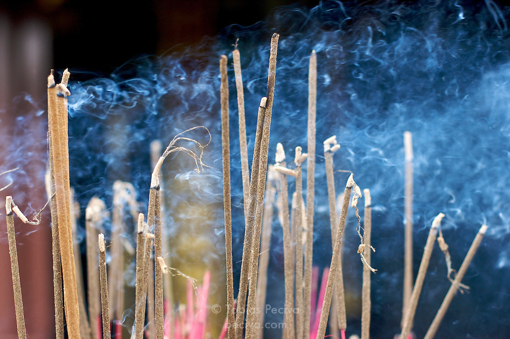 Incense burning outside the Thien Mu Pagoda, near the old imperial capital of Hue, Vietnam.