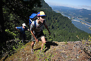 Hikers Hamilton Boyce (front) and Zach Podell-Eberhardt veer from the Ruckel Creek Trail, on the Oregon side, to climb up a knife-edge ridge promising views of the Columbia River Gorge.