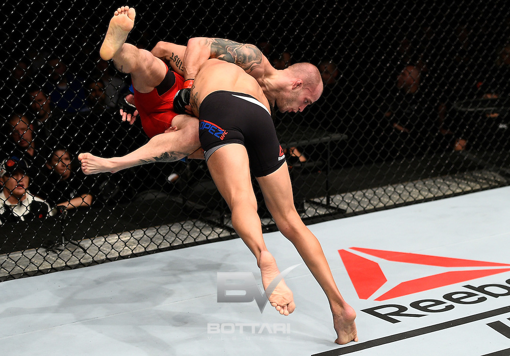 TORONTO, CANADA - DECEMBER 10:  (R-L) Matthew Lopez takes down Mitch Gagnon of Canada in their bantamweight bout during the UFC 206 event inside the Air Canada Centre on December 10, 2016 in Toronto, Ontario, Canada. (Photo by Jeff Bottari/Zuffa LLC/Zuffa LLC via Getty Images)