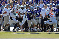 Kansas State running back Leon Patton (14) splits Oklahoma State defenders Donovan Woods (8) and Andre Sexton (20) in the second half at Bill Snyder Family Stadium in Manhattan, Kansas, October 7, 2006.  The Wildcats beat the Cowboys 31-27.<br />
