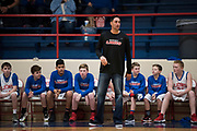 Durant Middle School 7th grade boys basketball coach, Zach Willingham, calls a play for his team in Durant, Oklahoma on January 27, 2017.  (Cooper Neill for The New York Times)