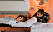 18 MARCH 2016 -- ST. LOUIS -- Carlei Huff, a cancer patient from Farmington, Mo., prepares for a CT scan with Kyle Hurtgen (right), Lead Nuclear Medicine Tech at SSM Cardinal Glennon Children's Medical Center  in St. Louis, as her parents Chuck and Vicky Huff watch Friday, March 18, 2016. Carlei was at the hospital for a battery of tests that were part of her six-month check up for treatment of the bone cancer osteosarcoma. Photo © copyright 2016 Sid Hastings.