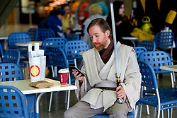 © Licensed to London News Pictures. 25/10/2015. London, UK. A cosplayer dressed as Obi-Wan Kenobi attending the MCM London Comic Con at ExCeL Convention Centre on Sunday, 25 October 2015. Photo credit: Tolga Akmen/LNP