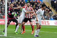 Southampton's Graziano Pelle (19) is held by Swansea's Jack Cork at a corner. Barclays Premier league match, Swansea city v Southampton at the Liberty Stadium in Swansea, South Wales on Saturday 13th February 2016.<br /> pic by  Carl Robertson, Andrew Orchard sports photography.