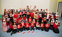 NEWPORT, WALES - Tuesday, October 7, 2014: Wales' Jonathan Williams, David Cotterill and Neil Taylor with children from Mount Stuart School for a Show Racism the Red Card promotion ahead of the UEFA Euro 2016 qualifying match against Bosnia and Herzegovina. (Pic by David Rawcliffe/Propaganda)