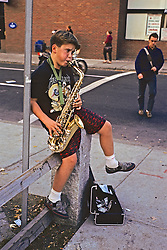Boy Playing Saxophone For Money
