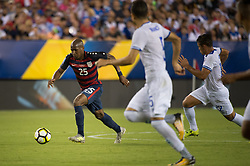 July 19, 2017 - Philadelphia, Pennsylvania, U.S - United States of America midfielder DARLINGTON NAGBE (25) takes the ball upfield while chased by El Salvador defender IVAN MANCIA (5) during CONCACAF Gold Cup 2017 quarterfinal action at Lincoln Financial Field in Philadelphia, PA.  USA  defeats El Salvador 2 to 0. (Credit Image: © Mark Smith via ZUMA Wire)