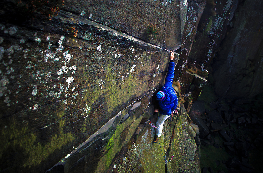 Leon Zablocki on the first ascent of Fox House Fake, Burbage South Quarries, Nr  Sheffield, England.