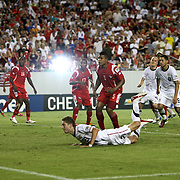 USA defender Clarence Goodson (21) watches as the ball enters the net for a U.S. goal during the second half of a CONCACAF Gold Cup soccer match between the United States and Panama on Saturday, June 11, 2011, at Raymond James Stadium in Tampa, Fla. (AP Photo/Alex Menendez)