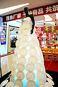 LIAONING, CHINA - JANUARY 28: (CHINA OUT) <br /> <br /> Plate Dress <br /> <br /> A fiberglass model wears a dress made of 135 bone plates at a mall on January 28, 2015 in Shenyang, Liaoning province of China. The selling price of the bone plate are 7.6 dollars per unit. <br /> ©Exclusivepix Media
