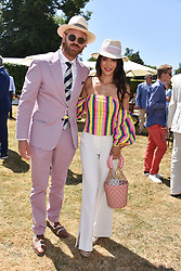 Alistair Guy and Vicky Lee at the 'Cartier Style et Luxe' enclosure during the Goodwood Festival of Speed, Goodwood House, West Sussex, England. 15 July 2018.