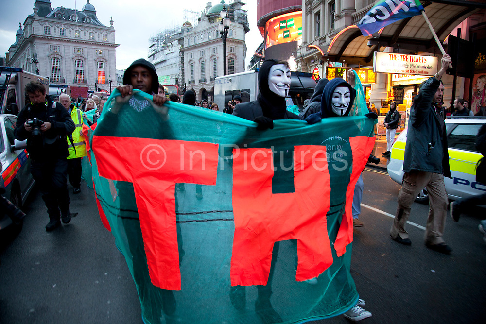 Anti-capitalist protesters wearing Anonymous UK masks split off from the mail N30 demonstration. This then quickly escalated into an attempt to occupy a buliding on Panton Street.