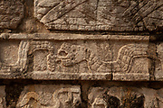 Snake carvings on a Tzompantli or Skull Platform in Chichen Itza, a large pre-Columbian city built by the Maya