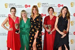 Morgana Robinson (centre) and Sharon Horgan (far right) and their BAFTA for Morgana Robinson's Summer at the Virgin TV British Academy Television Awards 2018 held at the Royal Festival Hall, Southbank Centre, London.