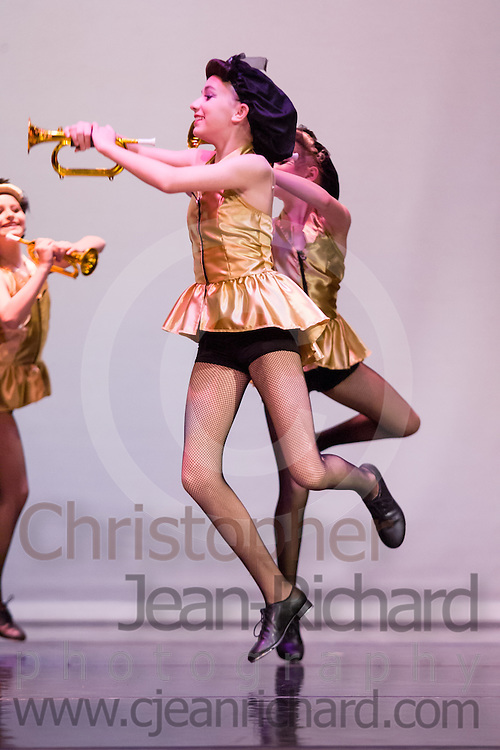 Students of the Payne Academy of Performing Arts in the dress rehearsal of Jazz and Tap choreography.<br /> <br /> Woodlands College Park High School Theater.The Woodlands, Texas