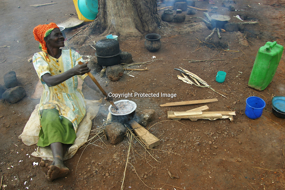 african woman cooking