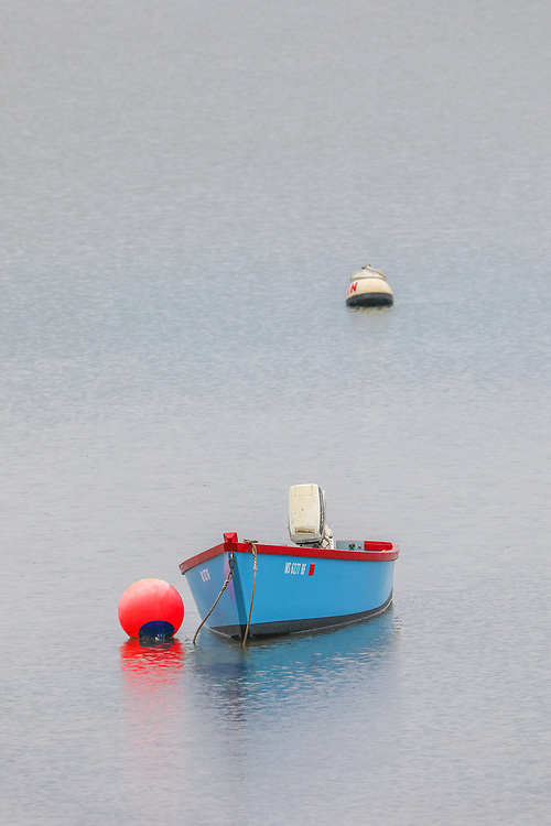 Massachusetts South Shore harbor scenery of a blue dinghy on a rainy day in May.  <br /> <br /> Blue dinghy photography pictures are available as museum quality photo, canvas, acrylic, wood or metal prints. Wall art prints may be framed and matted to the individual liking and wall art décor project needs:<br /> <br /> https://juergen-roth.pixels.com/featured/harbor-scenery-from-the-massachusetts-south-shore-juergen-roth.html<br /> <br /> Good light and happy photo making!<br /> <br /> My best,<br /> <br /> Juergen<br /> Photo Prints & Licensing: http://www.rothgalleries.com<br /> Photo Blog: http://whereintheworldisjuergen.blogspot.com<br /> Instagram: https://www.instagram.com/rothgalleries<br /> Twitter: https://twitter.com/naturefineart<br /> Facebook: https://www.facebook.com