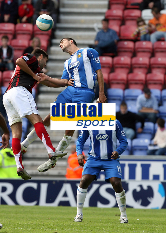 Photo: Sportsbeat Images.<br />Wigan Athletic v Fulham. The FA Barclays Premiership. 15/09/2007.<br />Wigan's Paul Scharner (R) beats Fullham's Chris Baird in the air